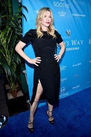Courtney Love complemented her elegant dress with black crisscross-strap platform peep-toes by Christian Louboutin.