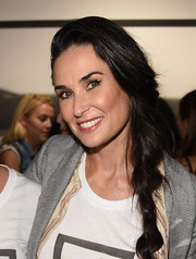 Demi Moore topped off her look with a boho-inspired loose braid when she attended Brian Bowen Smith's Wildlife show.