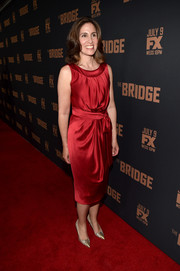 Carolyn Bernstein kept it classic and sophisticated in a red silk cocktail dress during the premiere of 'The Bridge.'