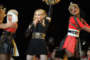 Madonna wore a gold-emblazoned black dress for her Super Bowl halftime performance.