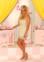 The blonde bombshell looked adorable in a tiny sheer mini dress with metallic sandals featuring wrapped ankle straps.