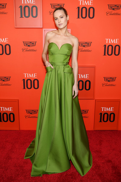 Brie Larson Strapless Dress [red carpet,dress,clothing,green,gown,carpet,red carpet,shoulder,strapless dress,fashion model,flooring,brie larson,time 100 gala,time 100 gala red carpet,jazz,new york city,lincoln center]