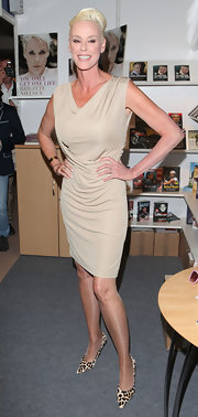 This simple nude cocktail dress was perfection on Brigitte Nielsen.