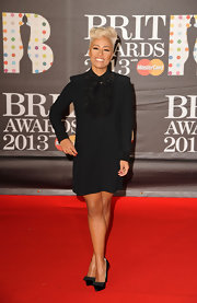 We loved Emeli Sande's boyish take on the LBD. The neck ruffles and boxy shape made her look chicly suited up for the occasion.