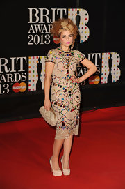 Paloma Faith loves to be playfully tacky on the red carpet and the Brits were no exception. The singer rocked a dress any little girl would kill for as it was adorned with youthfully bright chunky plastic gems.