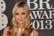 Laura Whitmore chose beachy waves to show off her signature gold locks at the 2013 Brits.