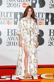 Lana Del Rey teamed her gown with a pair of mustard-colored fur sandals.
