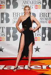 Lily Donaldson amped up the sexiness with a pair of diagonal-strap sandals, also by Anthony Vaccarello.