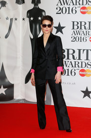 Noomi Rapace was sleek and smart in a black pantsuit with fuchsia cuffs during the Brit Awards.
