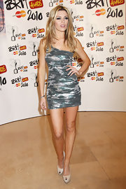 Abbey Clancy sizzled in an ultra-short camouflage-print one-shoulder dress at the Brit Awards.