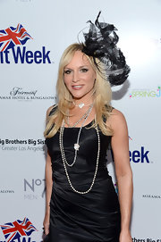 Stacey Jackson complemented her simple LBD with an elaborate black fascinator at the BritWeek Celebrates Downton Abbey event.