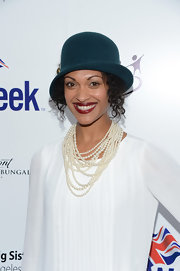 Cynthia Addai-Robinson channeled the 1920s with this teal cloche at the BritWeek Celebrates Downton Abbey event.