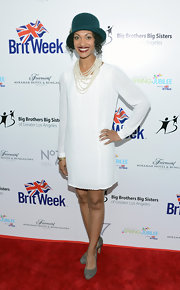 Cynthia Addai-Robinson chose a long-sleeve white shift dress for her 1920s-inspired look during the BritWeek Celebrates Downton Abbey event.