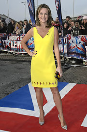 Amanda Holden arrived for the first day of auditions in Cardiff in a bold yellow dress with diamond cut-outs and a lightning-like neckline.