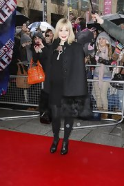 Amanda Holden arrived at 'Britain's Got Talent' auditions in drizzly Manchester wearing a fur-trimmed black cape.