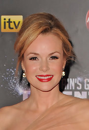 Amanda Holden arrived at a pre-final party for 'Britian's Got Talent' wearing her hair in a voluminous French Twist.