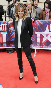 Amanda Holden chose a fitted black blazer with satin lapels for her look at the 'Britain's Got Talent' press event.