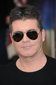 A pair of black aviators topped off Simon Cowell's sleek and sophisticated red carpet look.