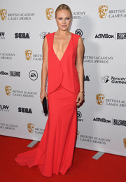 Malin Akerman sizzled in a plunging red gown at the 2018 British Academy Game Awards.