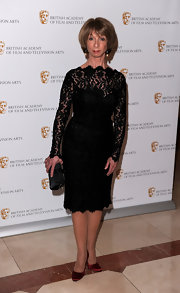 Helen Worth paired her lace cocktail dress with satin pumps and clutch.