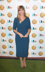 Kate Garraway chose sleek and sophisticated blue shift dress with a three-quarter-length sleeve.