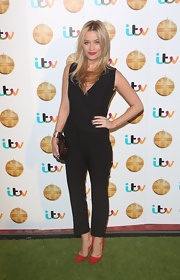 Laura Whitmore chose a sleeveless black jumpsuit for her sleek and contemporary evening look.
