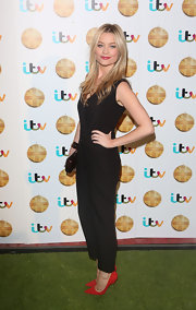 A pair of red pointy pumps added a bright pop of color to Laura Whitmore's look during the British Animal Honours.