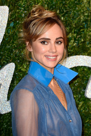 Suki Waterhouse attended the British Fashion Awards wearing her hair piled up in a messy-chic style.
