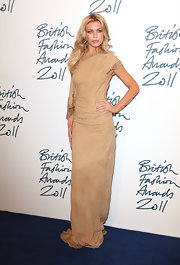 Abbey Clancy wore a tan suede evening dress with gold beaded edging for the British Fashion Awards.