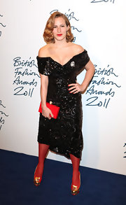 Charlotte Dellal accessorized her off-the-shoulder cocktail dress with red tights and metallic platform pumps.