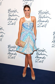 Amber Le Bon added sparkle to her lovely print frock with a glittery gold clutch at the British Fashion Awards.