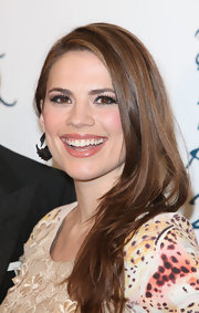 Hayley Atwell wore a shiny golden apricot lipstick topped with clear gloss for an evening at the 2011 British Fashion Awards.