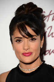 Piece-y bangs gave Salma's loose bun an elegant edge.
