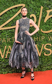 Erin O'Connor went for goth glamour at the British Fashion Awards in a fit-and-flare dress featuring a dark, moody print.