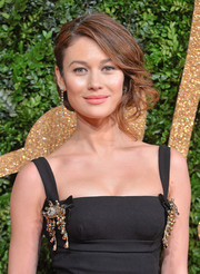 Olga Kurylenko looked as glamorous as ever wearing this side-swept updo at the British Fashion Awards.