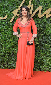 Salma Hayek got all frilled up in a coral ruffle gown by Gucci for the British Fashion Awards.
