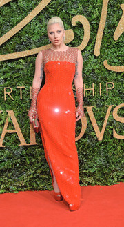 Lady Gaga exuded modern glamour at the British Fashion Awards in a sheer-panel red Tom Ford gown rendered in honeycomb paillettes.