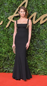 Olga Kurylenko made an appearance at the British Fashion Awards wearing a black Dolce & Gabbana gown rendered in a figure-flattering mermaid silhouette.