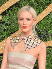Poppy Delevingne's red lippy looked striking against the muted pink of her outfit.