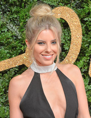 Mollie King swept her hair up into a loose top knot for the British Fashion Awards.