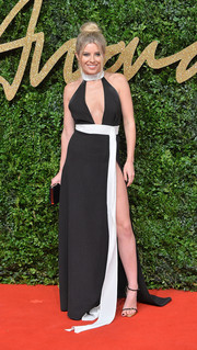 Mollie King was all cleavage and legs in this black-and-white PPQ halter gown at the British Fashion Awards.