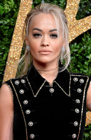 Rita Ora attended the British Fashion Awards rocking a disheveled updo.