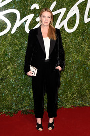 Anya Hindmarch teamed her suit with black cross-strap sandals for a more feminine finish.