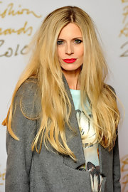 Laura Bailey flaunted her long blond locks while attending the British Fashion Awards.