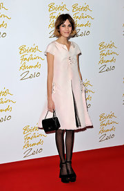 Alexa Chung added classic charm to her red carpet look with her black Chanel bag.