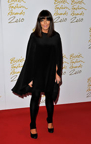 Claudia wears a lovely silk evening cape for the British Fashion Awards.