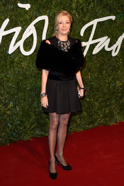 Nadja Swarovski paired a black fur stole with an LBD for the British Fashion Awards.
