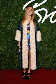 Alexia Niedzielski arrived for the British Fashion Awards looking gangsta-chic in a quilted teal coat with white fur detail.