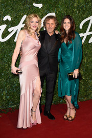 Courtney Love was equal parts sexy and sweet at the British Fashion Awards in a pink satin gown with a cowl neckline and a ruffle hem.