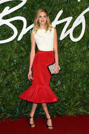 A Nathalie Trad patterned mother-of-pearl box clutch added an extra dose of sophistication to Tamsin Egerton's look.